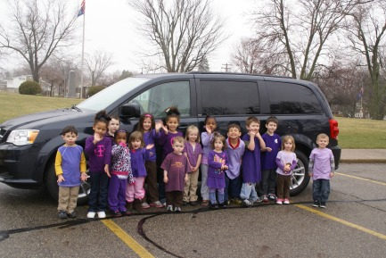 Children from the Ladies Auxiliary Nursery welcome our 6th Campbell's van to campus.