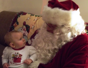 2 Little girl looking up at Santa
