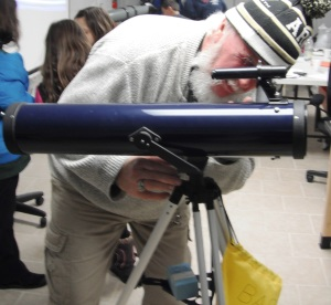 Dave Westjohn, Education Specialist, looking out of telescope