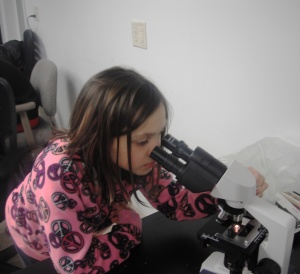 Girl looking into microscope2