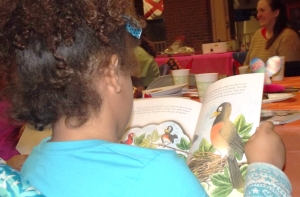 Close-up of little girl reading